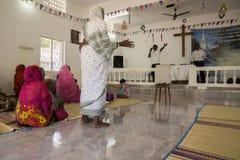 Women praying in protestant church Stock Image