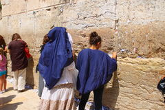 Women prays at the Wailing Wall. Stock Photo