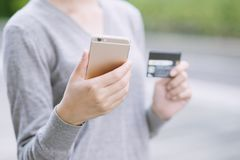 Women prefer shopping online with a credit card via mobile phone. stock photos