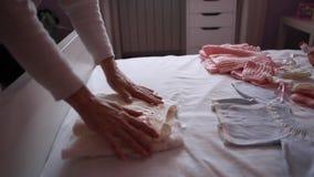 Women preparing carefully clothing of baby stock footage