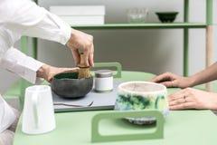 Making of green matcha tea Stock Photos