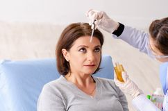 Woman preparing for cosmetic plastic surgery. The women preparing for cosmetic plastic surgery royalty free stock images
