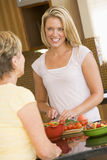 Women Preparing Dinner. And Smiling royalty free stock images