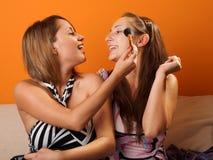 Women preparing make up Stock Images
