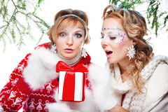 Women with present wrapped in white paper Royalty Free Stock Image