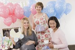 Women With Presents At A Baby Shower Royalty Free Stock Photography