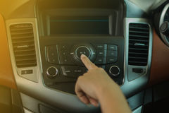 Women press buttom on car radio. Women press buttom car radio stock image