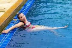 Free Women Pretty With Red Bikini At Swimming Pool On Beac Stock Photo - 111608050