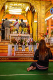 Women prohibited sign with a praying woman in buddhist temple,. Women prohibited sign with a woman praying in buddhist temple,  Myanmar Royalty Free Stock Photos