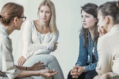 Women and psychologist talking about career during meeting royalty free stock image