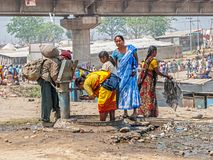 Women by the public tap, Kumbh Mela Royalty Free Stock Image