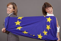 Women pulling on european flag Stock Image