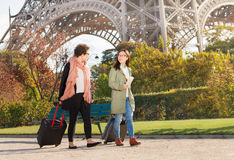 Women pulling suitcases along the street of Paris Stock Photos