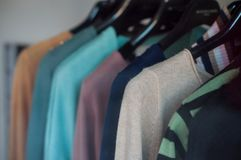 Women pullover on hangers in fashion store. Closeup of women pullover on hangers in fashion store Stock Photography