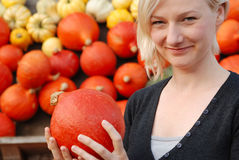 Women with Pumpkins Stock Photography