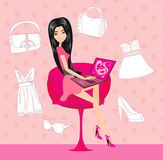 Women purchasing product online using her laptop computer Royalty Free Stock Images