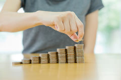 Women put coin stack money for money growth. Concept Stock Images