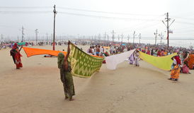 Women put their sari out to dry on wind after ritual holy bathing in the Ganges river Stock Photo