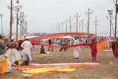 Women put their sari out to dry on wind after ritual holy bathing in the Ganges river Royalty Free Stock Photo