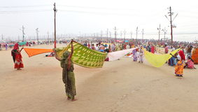 Women put their sari out to dry on wind after ritual holy bathing in the Ganges river Royalty Free Stock Images
