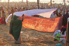 Women put their sari out to dry on wind after ritual holy bathing in the Ganges river Royalty Free Stock Photography