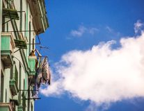 Women putting clothes to dry. On a balcony in Havana Royalty Free Stock Photo