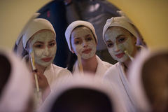 Women putting face masks in the bathroom Royalty Free Stock Photo