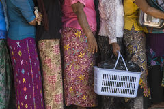 Women in  queue. Women with gifts in the queue  in Myanmar. A feast of giving gifts to monks Royalty Free Stock Image