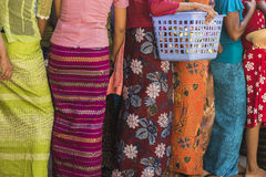 Women in queue. Women with gifts in the queue in Myanmar. A feast of giving gifts to monks royalty free stock photo