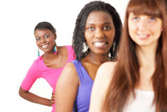 Women queue with peering girl. Three women in a queue with a smiling peering girl stock photo
