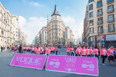 Women race against breast cancer. Barcelona, Spain - November 8, 2015: Women in pink T-shirts march in the heart of the city on day dedicated to women race Royalty Free Stock Photography
