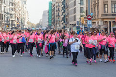 Women race against breast cancer. Barcelona, Spain - November 8, 2015: Women in pink T-shirts march in the heart of the city on day dedicated to women race Royalty Free Stock Photos