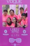 Women race against breast cancer. Barcelona, Spain - November 8, 2015: Women take photos near Vogue banner, dedicated to women race against breast cancer Stock Photo
