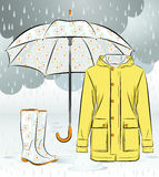 Women rain boots, jacket and umbrella with floral pattern Royalty Free Stock Images