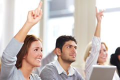 Women raising hands in class Royalty Free Stock Photography