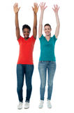 Women raising their arms up in excitement Stock Images