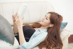 Women read happy books on the couch. Stock Image