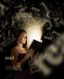 Women Reading. A woman reading a glowing book at night Royalty Free Stock Photos