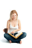 Women Reading a Book. With Coffee Cup Royalty Free Stock Images