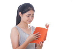 Women reading a book stock images