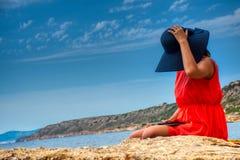 Women reading e-book on beach royalty free stock image