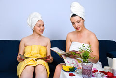 Women reading magazines at spa salon Royalty Free Stock Image