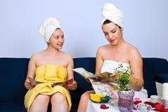 Women reading magazines at spa salon Royalty Free Stock Image
