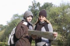 Women Reading Map Outdoors Stock Photos