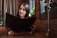Women reading Menu. Beautiful middle-aged women reading Menu at Royalty Free Stock Photo