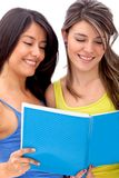 Women reading from a notebook Royalty Free Stock Photos