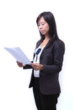 Women reading a paper sheet Royalty Free Stock Images