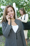 Women Real Estate Agents. A beautiful young real estate agent woman on the phone Stock Images