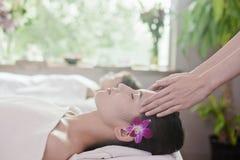 Women Receiving Head Massage Stock Photos