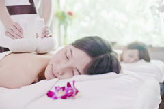 Women Receiving Herbal Massage Royalty Free Stock Photos